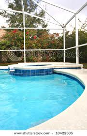 swimming pool with a hot tub extension